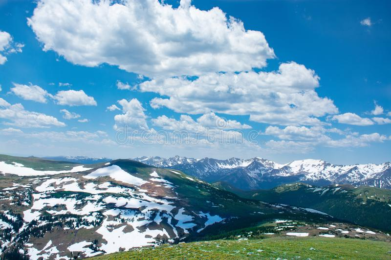 Beautiful Colorado spring landscape with green meadows and snow covered mountains. View from Trail Ridge Road. Rocky Mountains National Park. Close to Estates royalty free stock photos