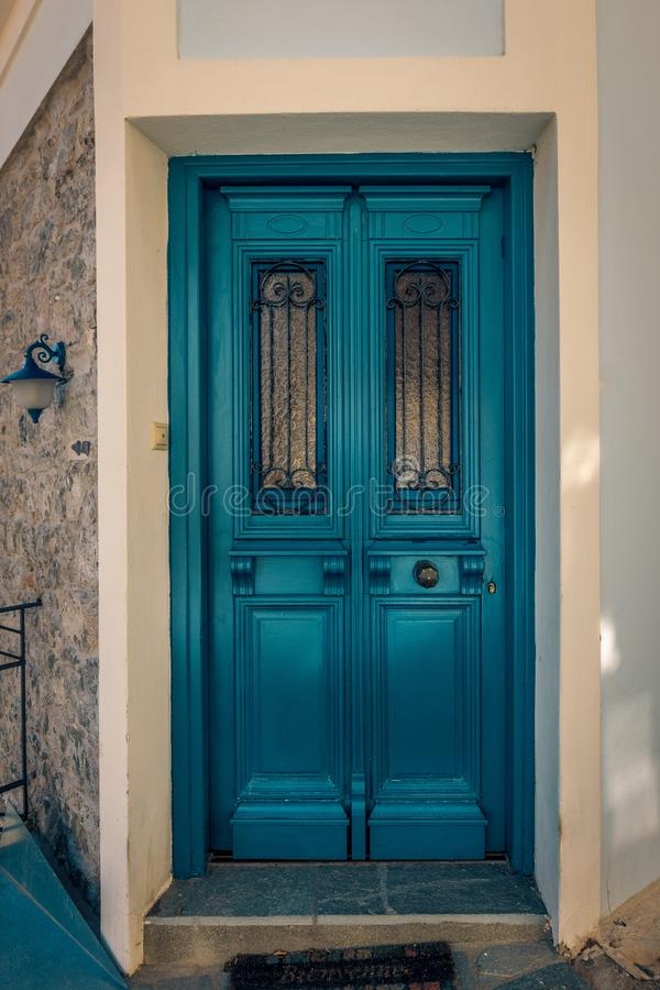 Beautiful colored door entrance into a picturesque house in the royalty free stock image