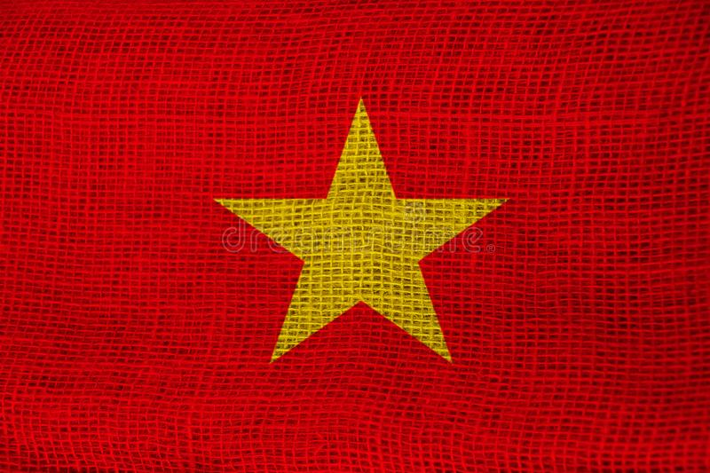 Beautiful colored national flag of vietnam state on fabric with technological modern pattern, closeup stock photography