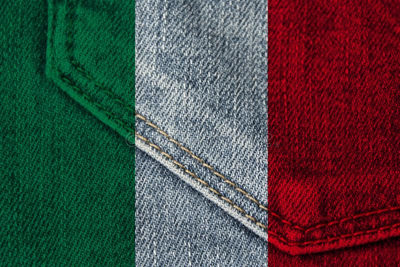 Beautiful colored photograph of the beautiful colored national flag of the modern state of Italy on textured fabric, concept of. Tourism, emigration, economics royalty free stock photo
