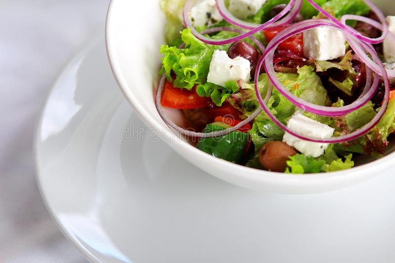 beautiful colorful assorted salad in white plate stock image