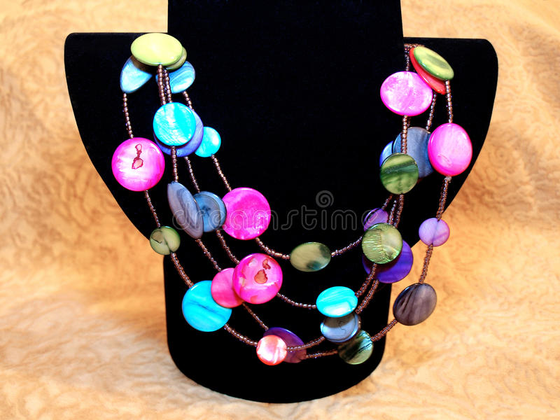 Beautiful colorful beads of natural nacre on black bust stock photos