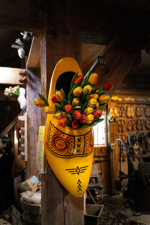 Beautiful colorful bouquets of wooden tulips in the wooden shoe. Decoration of a Dutch souvenir shop in Zaanse Schans, Netherlands royalty free stock photos