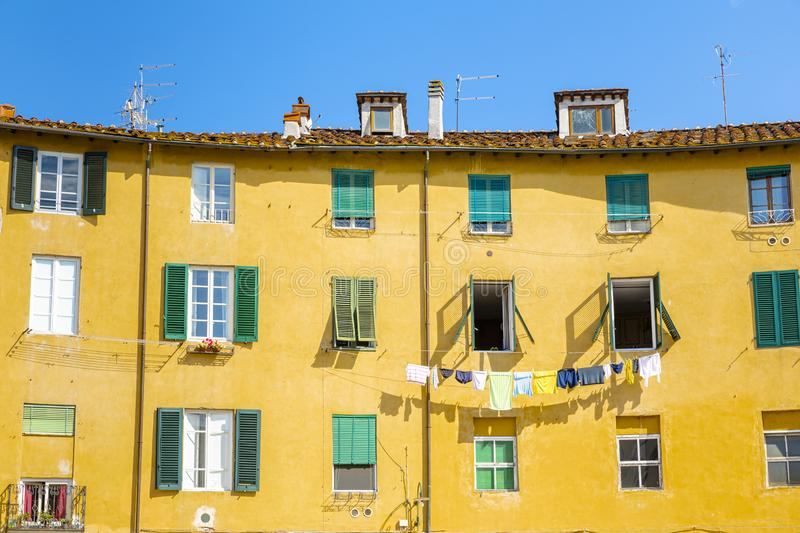 Beautiful colorful building on square - Piazza dell Anfiteatro in Lucca. Tuscany, Italy stock photo