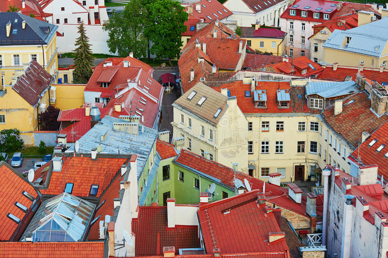 Beautiful colorful buildings with red tile roofs in Vilnius Old Town. Photo taken from Church of Saint Johns; Lithuania royalty free stock image