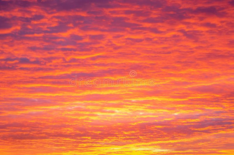 Beautiful colorful cloudy sky at sunrise. Sunrise. Dramatic orange blue sky with sun rays breaking through the clouds. Nature background royalty free stock image