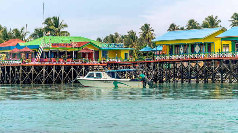 Beautiful and colorful cottages at Derawan Island Resort stock photography