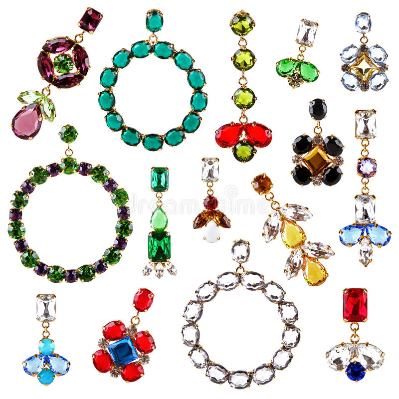 Beautiful colorful crystal earrings collection isolated on white. Background royalty free stock photography