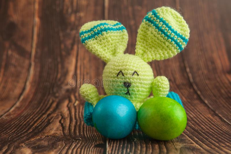 Beautiful colorful easter eggs and bunny toy. Easter concept on wooden background royalty free stock images