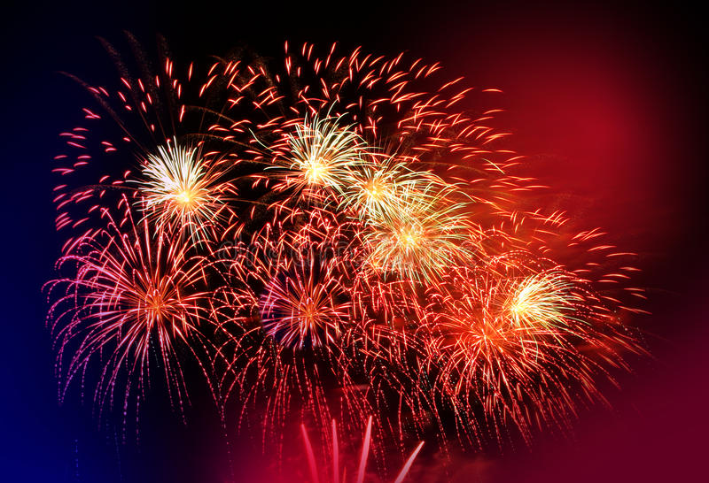 Beautiful red firework. Beautiful vibrant red firework in a night sky royalty free stock photography