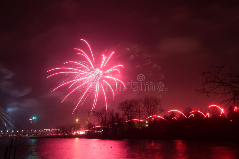 Beautiful, colorful fireworks above the river during an Independence day royalty free stock image