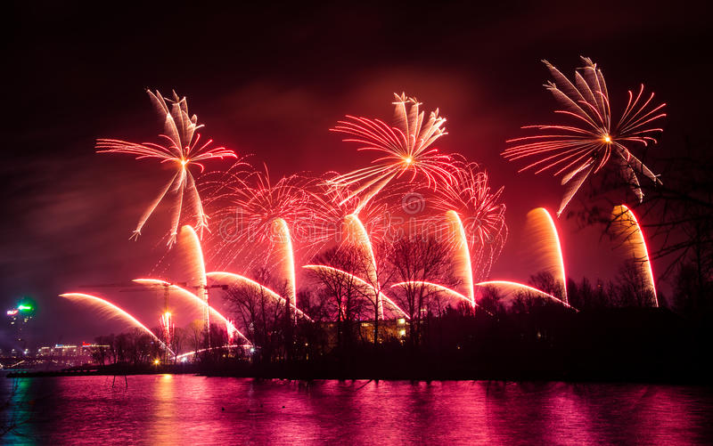 Beautiful, colorful fireworks above the river during an Independence day stock images