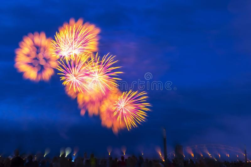 Beautiful colorful fireworks in the dark blue night sky - perfect for a background royalty free stock photo