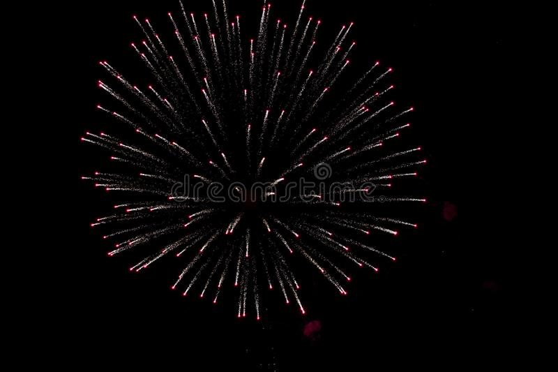 beautiful and colorful fireworks explossion over black sky background stock image