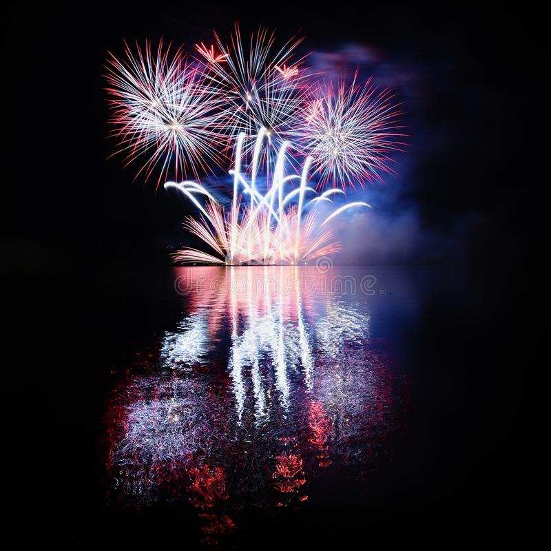 Beautiful colorful fireworks with reflections in water. Brno dam, the city of Brno-Europe. International Fireworks Competition. Beautiful colorful fireworks stock photography