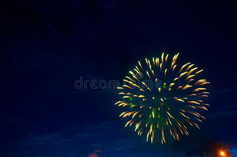 Fireworks in sky twilight. Fireworks display on dark sky background. Independence Day, 4th of July, Fourth of July or New Year royalty free stock image