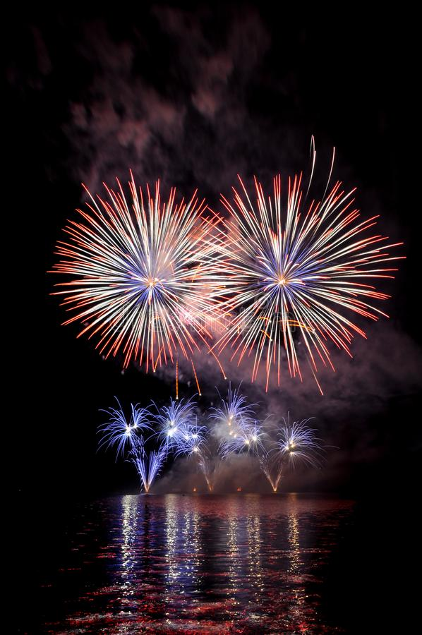 Beautiful colorful fireworks on water. Red, white and purple fireworks reflection. Brno dam. International Fireworks Competition stock photography