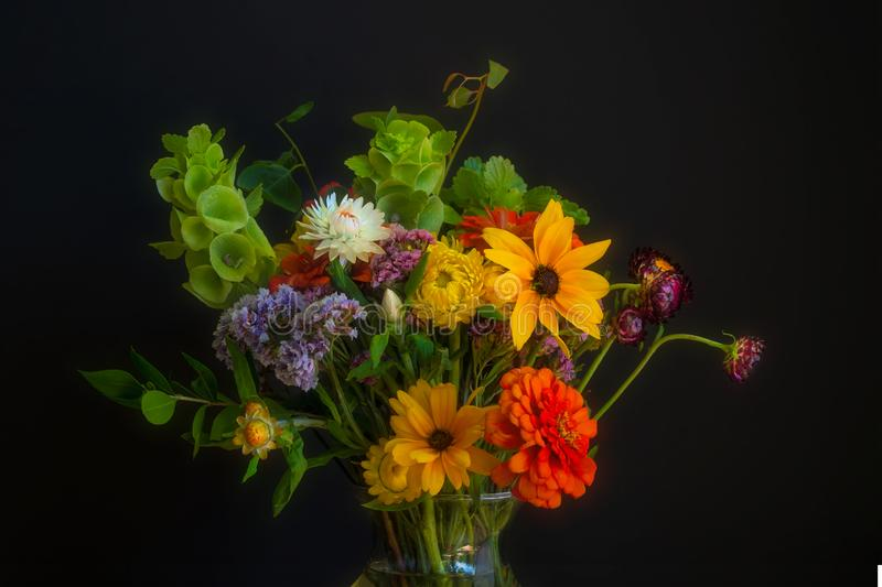 Colorful flowere bouquet. Beautiful and colorful flower bouquet, on dark bakground,  ideal for a greeting card royalty free stock photos