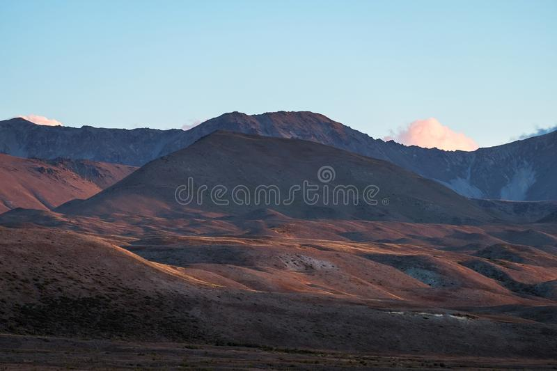 Beautiful colorful grassland mountain with blue sky at sunset. I. Beautiful colorful grassland mountain with blue sky at sunset royalty free stock photography