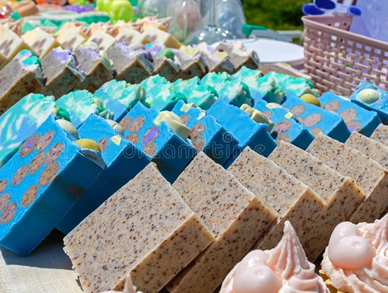 Beautiful colorful handmade soap. Soap manufacture Eco goods. Fair - an exhibition of folk craftsmen.  stock images