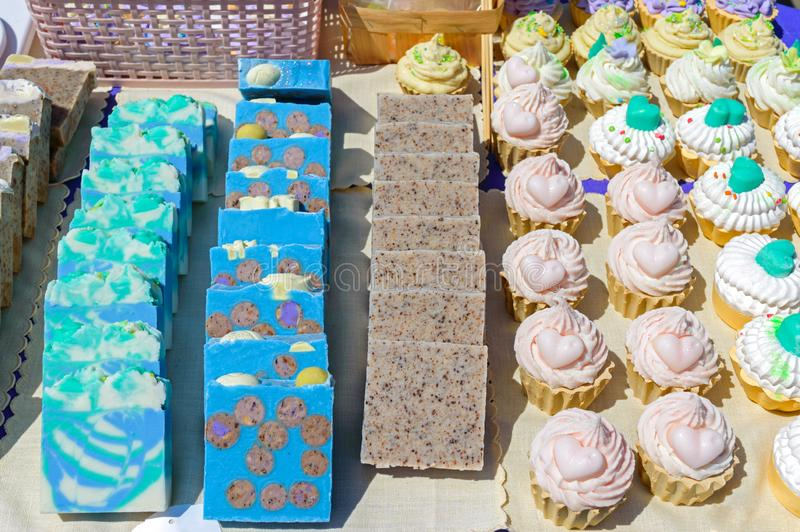 Beautiful colorful handmade soap. Soap manufacture Eco goods. Fair - an exhibition of folk craftsmen.  stock image