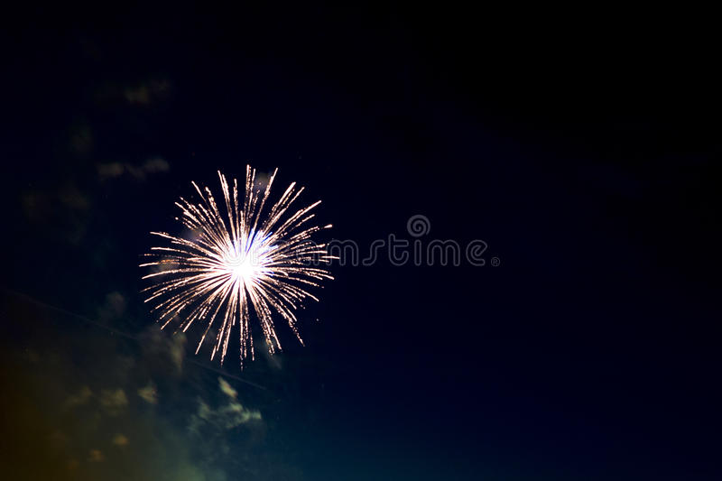 Beautiful colorful holiday fireworks on the black sky background stock photo