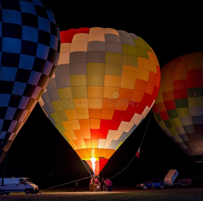 Beautiful and colorful hot air balloon ready for take-off at night stock image