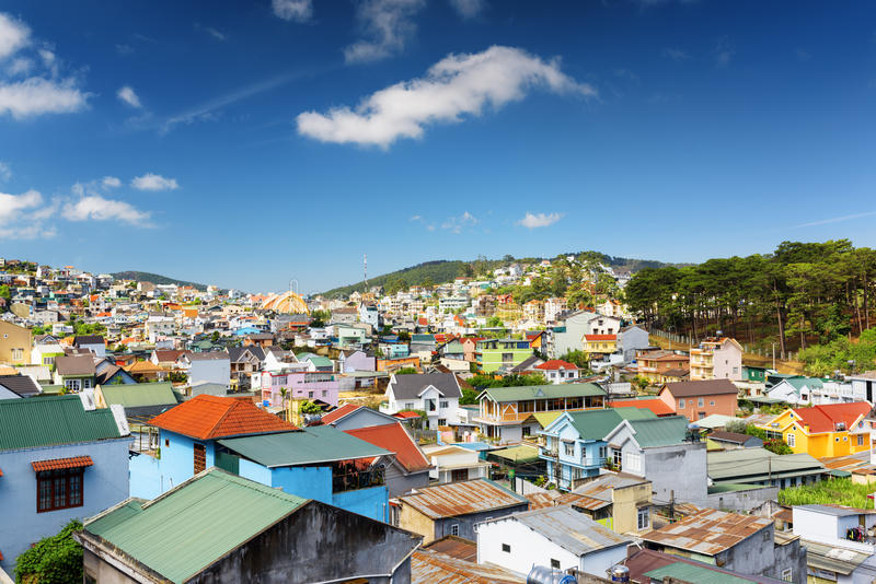 Beautiful colorful houses of Da Lat city (Dalat). On the blue sky background in Vietnam. Da Lat and the surrounding area is a popular tourist destination of stock images