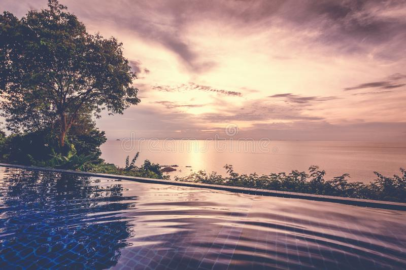 Beautiful colorful landscape, infinity pool in the sea at sunset royalty free stock photo