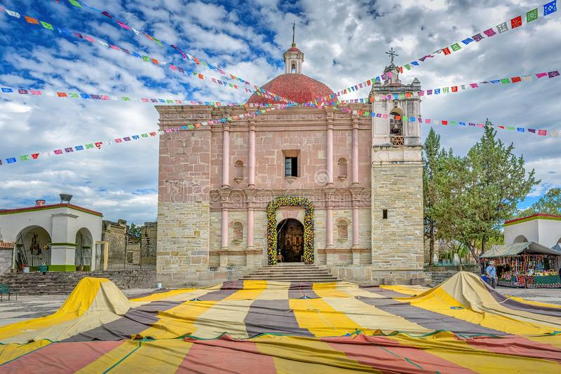 A beautiful colorful old church in Mitla, Mexico. A beautiful colorful old church in Mitla under cloudy skies, Oaxaca, Mexico stock photo