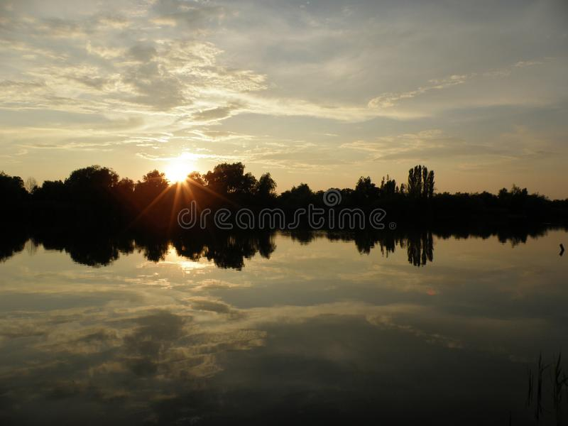 Sunset sky and the lake stock photography