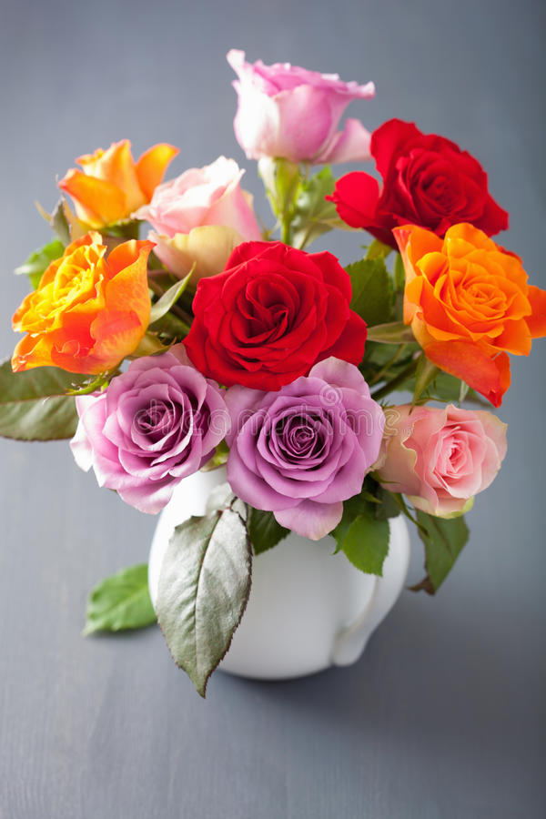 Beautiful colorful rose flowers bouquet in vase royalty free stock photos