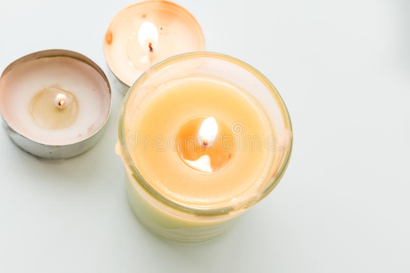 Beautiful colorful scented candles. Isolated on white background stock images