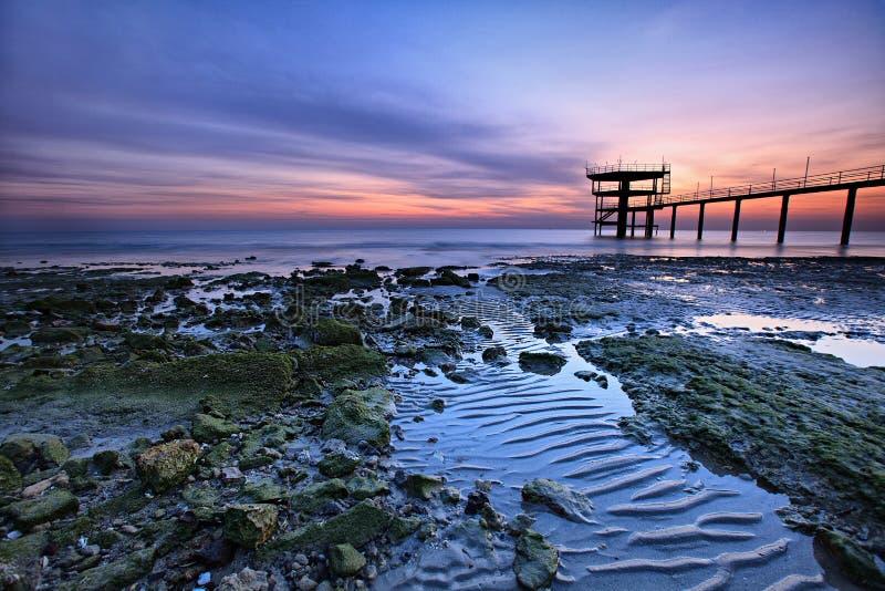 Beautiful colorful sunrise along the coast royalty free stock photography