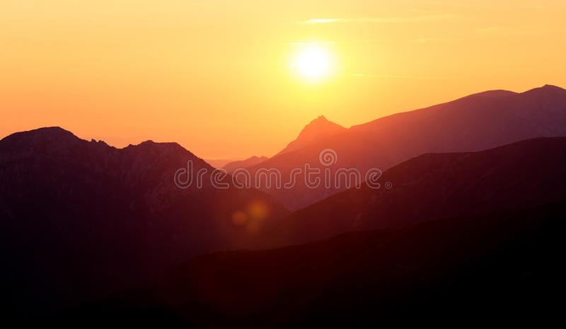 A beautiful, colorful sunrise sceney in mountains in purlpe tone. Abstract, minimalist landscape in Tatra mountains. Color gradien. Ts. Tatra mountains in stock image
