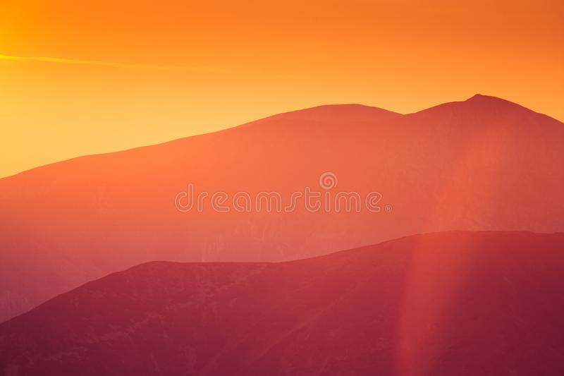 A beautiful, colorful sunrise sceney in mountains in purlpe tone. Abstract, minimalist landscape in Tatra mountains. Color gradien. Ts. Tatra mountains in stock photo