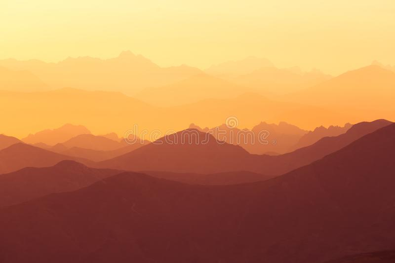 A beautiful, colorful sunrise sceney in mountains in purlpe tone. Abstract, minimalist landscape in Tatra mountains. Color gradien. Ts. Tatra mountains in stock photos