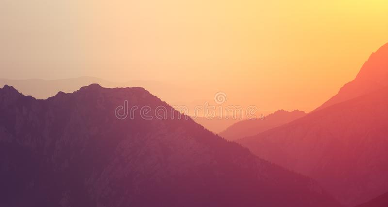 A beautiful, colorful sunrise sceney in mountains in purlpe tone. Abstract, minimalist landscape in Tatra mountains. Color gradien. Ts. Tatra mountains in stock images