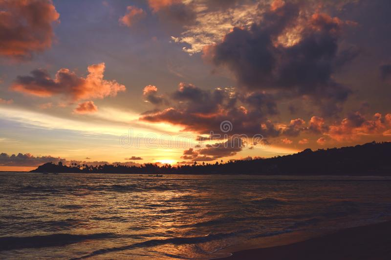 Beautiful colorful sunset over the ocean. Unawatuna beach, Sri Lanka. Beautiful colorful sunset over the Indian Ocean. Unawatuna beach, Sri Lanka royalty free stock images