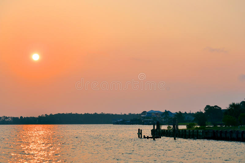 Beautiful Colorful Sunset Over the Water royalty free stock photos