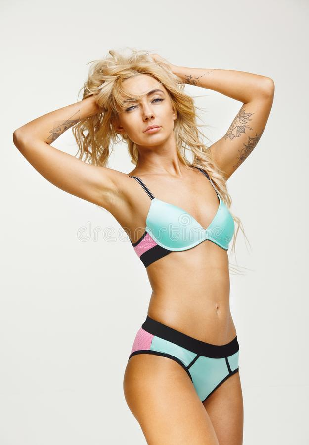 Beautiful and colorful swimwear for woman with slender figure on white isolated background. Bikini season. stock photos