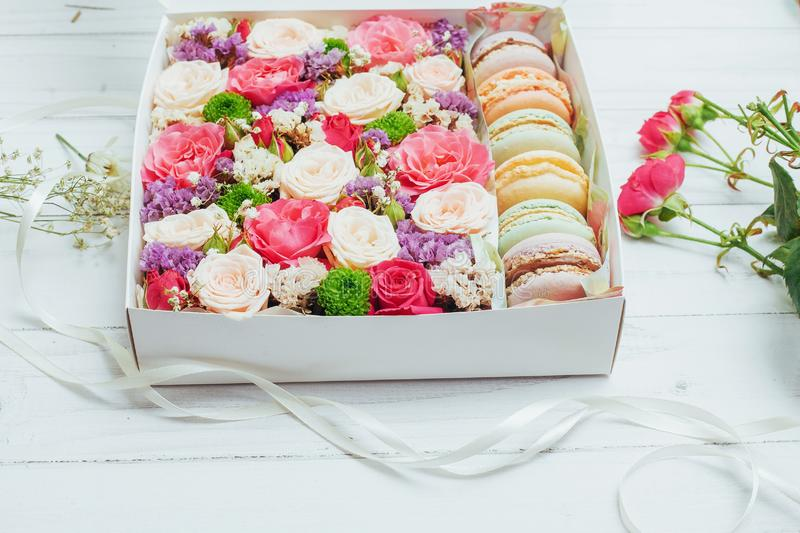 Beautiful colors of flowers and tasty Bizet. On white background royalty free stock photography