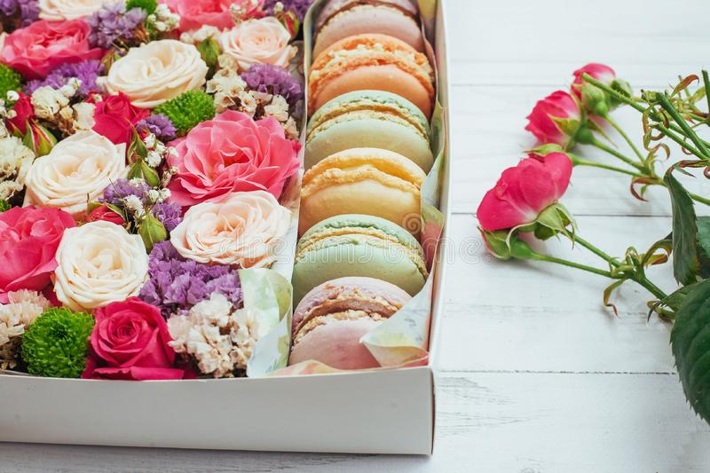 Beautiful colors of flowers and tasty Bizet. On white background royalty free stock images
