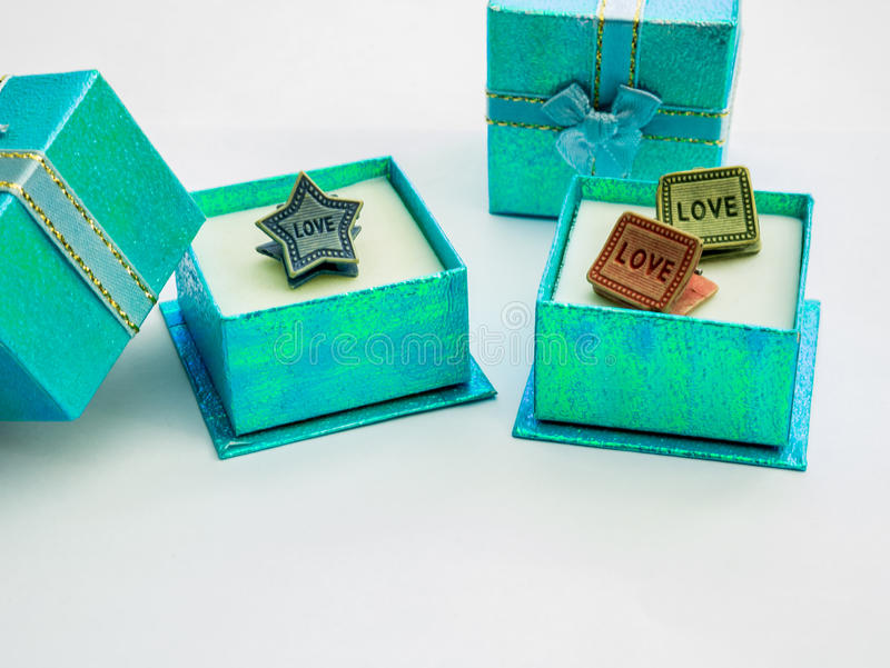 Beautiful colors gift boxes and cute paper clips. Small gift boxes is beautiful colors and cute paper clips stock photos