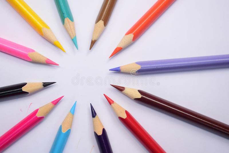 Beautiful colour pencils arranged in different beautiful pattern looking attractive charming appealing amazing. Beautiful colour pencils arranged different royalty free stock photography
