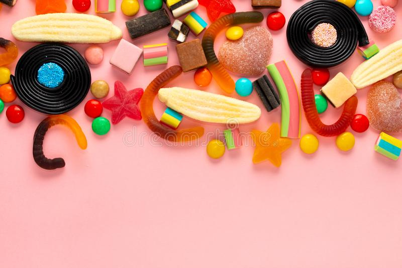 Colourful festive sweets and candies, top view with space for greetings. Beautiful colourful festive sweets and candies, top view with space for greetings royalty free stock photo