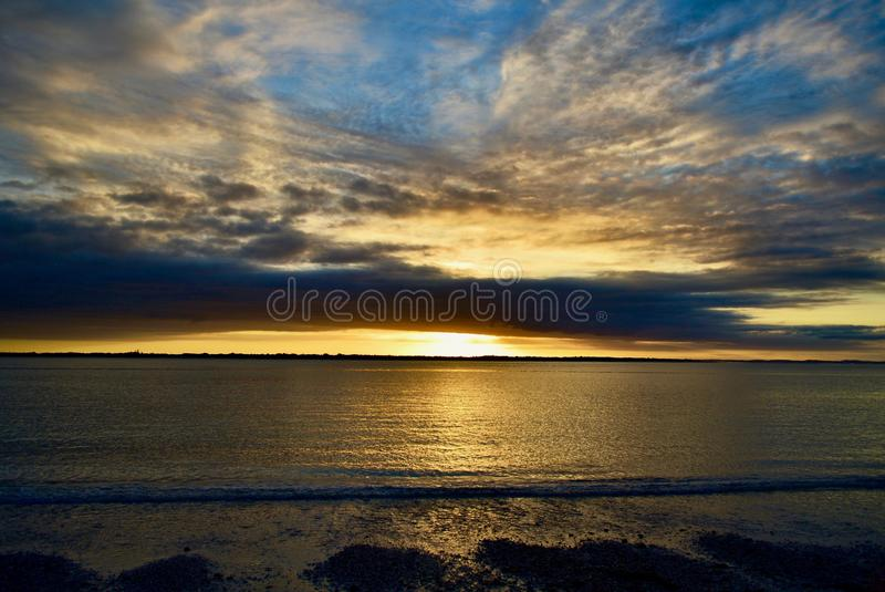 Dramatic evening sky with magnificent cloud formations. Beautiful colours of approaching night. Beautiful colours of approaching night; sky and sea in the stock image