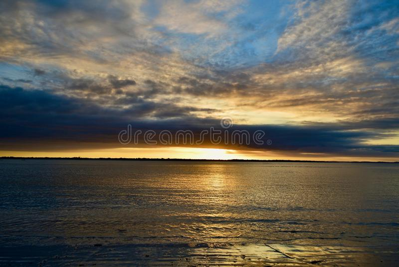 Dramatic evening sky with magnificent cloud formations. Beautiful colours of approaching night. Beautiful colours of approaching night; sky and sea in the stock photo