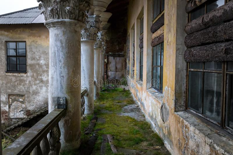On the balcony of the old abandoned house of culture of the Stalin era of the Soviet Union royalty free stock photos