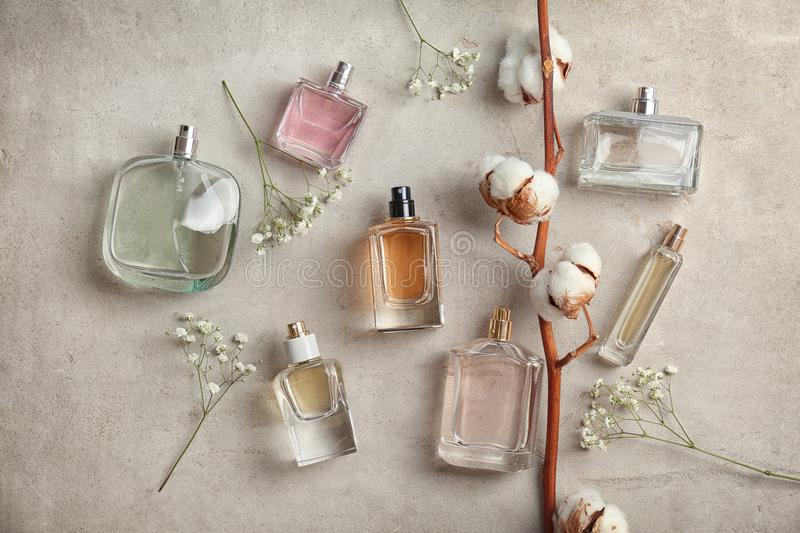 Beautiful composition with bottles of perfum e on light background, flat lay. Beautiful composition with bottles of perfume on light background, flat lay stock photo